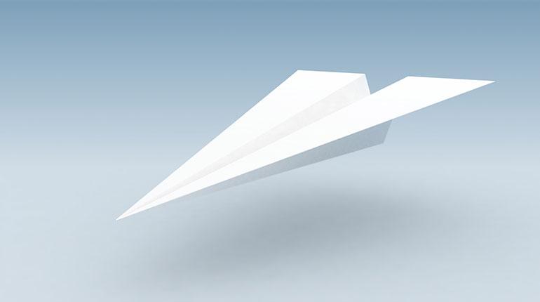 avion de papel blanco